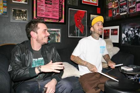 DJ AM and friend Travis Barker laugh it up