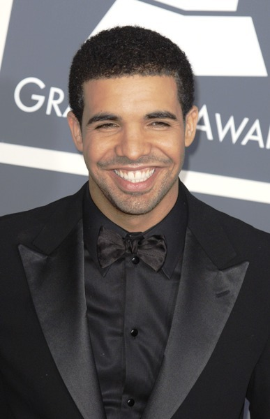 Drake smiling at the 53rd Annual Grammy Awards