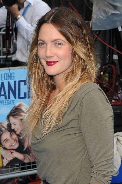 Drew Barrymore's braided and wavy hairstyle