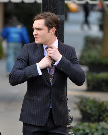 Ed Westwick adjusts his tie in Gossip Girls
