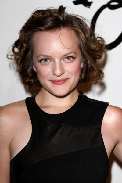 Elisabeth Moss' curly, brunette hairstyle