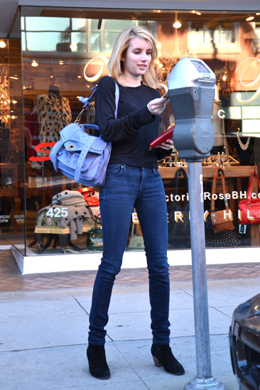 Emma Roberts feeds the meter before getting her nails done