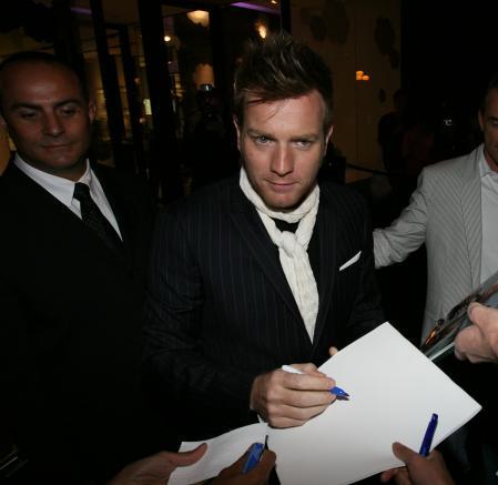 Ewan McGregor signs an autograph