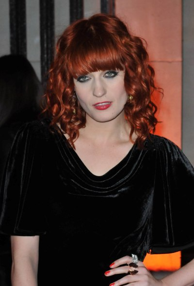 Florence Welchs red hairstyle with bangs was certainly eye catching. She rocked straight across bangs with her stunning