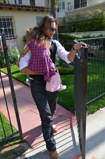 Gabriel Aubry picking up his daughter Nahla from school