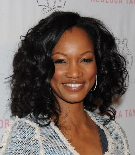Garcelle Beauvais' curly, shoulder-length hairstyle