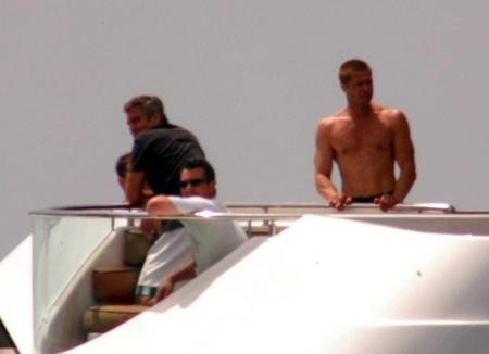George Clooney and Brad Pitt on a boat while on vacation