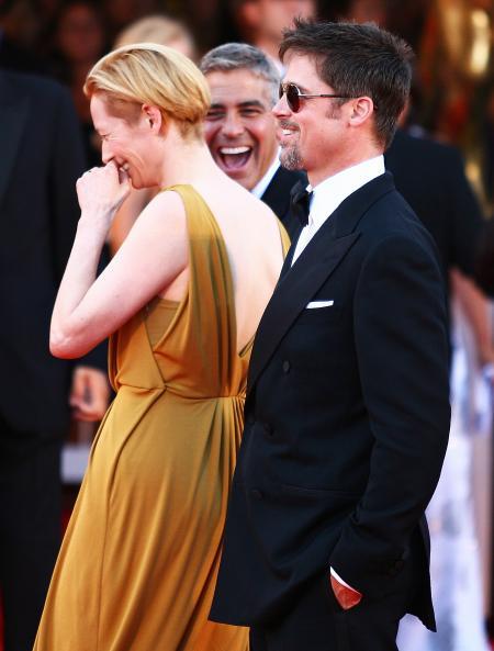 George Clooney walking with Tilda Swinton and Brad Pitt in Venice