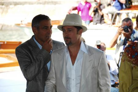 Brad Pitt and George Clooney get photographed at the Venice Film Festival