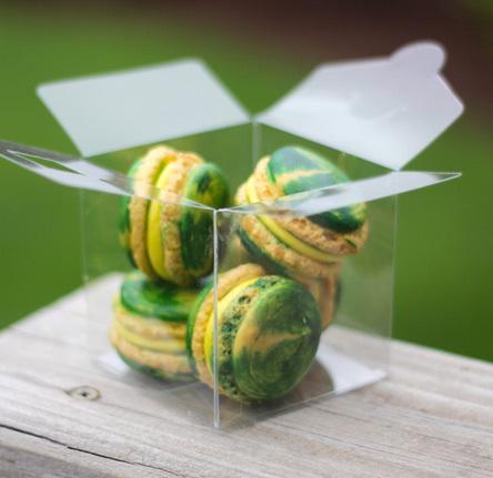 Green and yellow swirled macarons