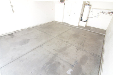 BEFORE: Cleared-out garage, ready to be renovated