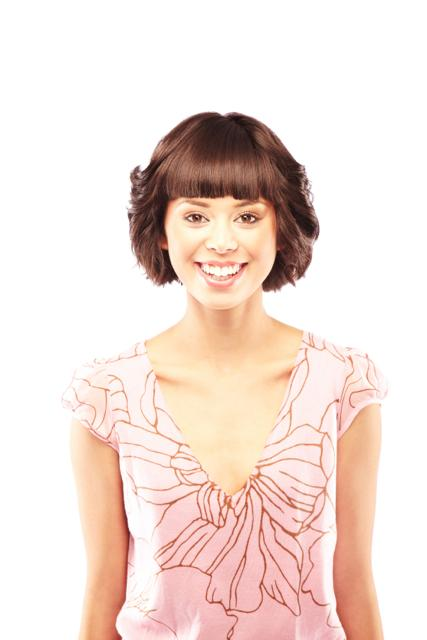 Hairstyles for round faces: Short Feathered Bob with Blunt Bangs