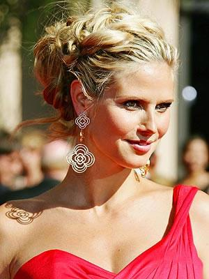 Heidi Klum in one-shoulder gown.