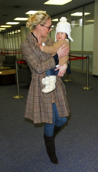 Katherine Heigl in plaid coat