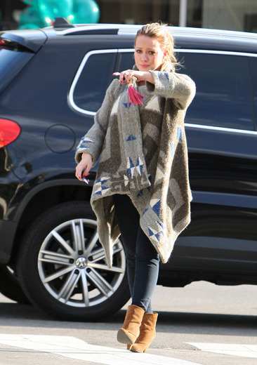 Hilary Duff cries as she goes to visit her ill dog