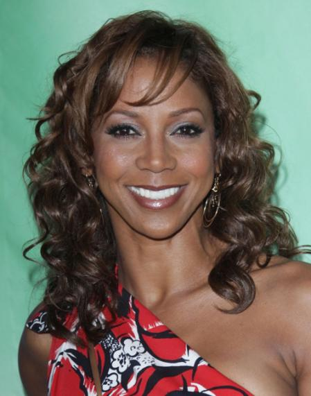 Holly Robinson Peete's long curly hairstyle