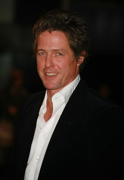 Hugh Grant attends the world premiere of 'The Golden Compass.'