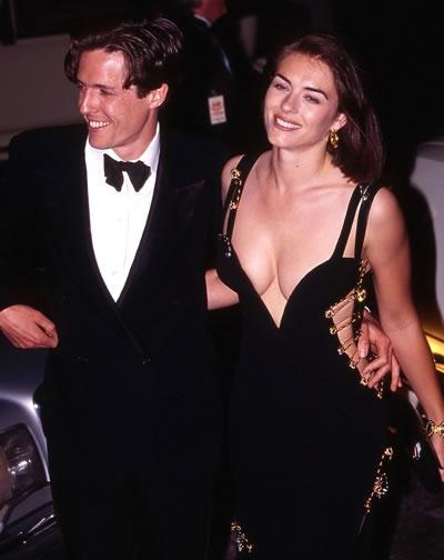 Hugh Grant and Liz Hurley arrive at the premiere of 'Four Weddings and a Funeral' in 1994. Hurley is wearing the famous