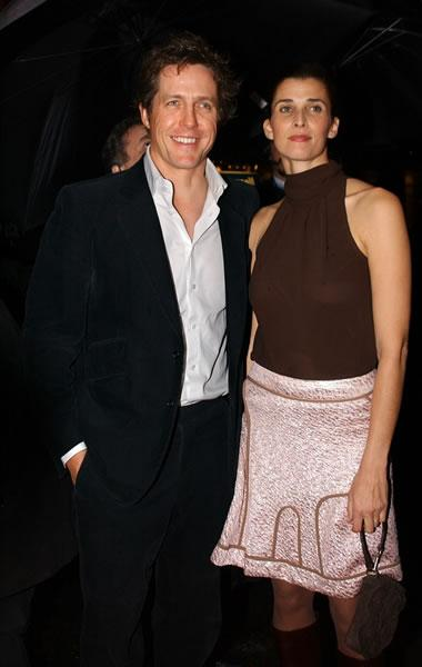 Hugh Grant with his date Rosario Saxe Coburg at the premiere of 'Love Actually.'