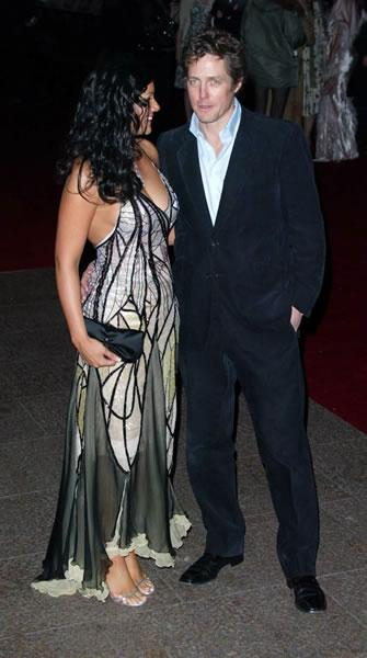 Hugh Grant appears at the London premiere of Love Actually with costar Martine McCutcheon.