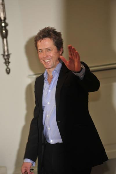 Hugh Grant greets photographers at a photocall for his film &#039;Did You Hear About the Morgans?&#039; in Rome.