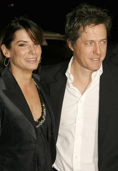Hugh Grant greets old friend Sandra Bullock at the premiere of 'Music and Lyrics.'