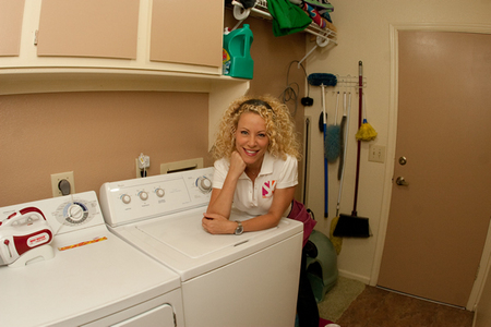 Tracy Metro poses in the laundry room