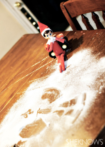 Elfie makes snow angels