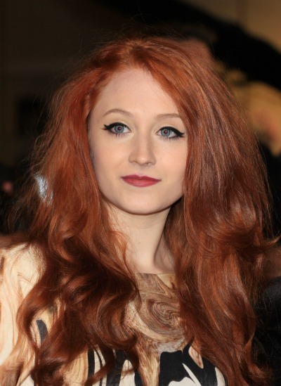 Janet Devlin's long, bright red waves