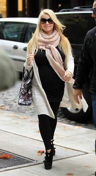 Jessica Simpson in scarf and cardigan