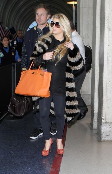 Jessica Simpson in orange stilettos