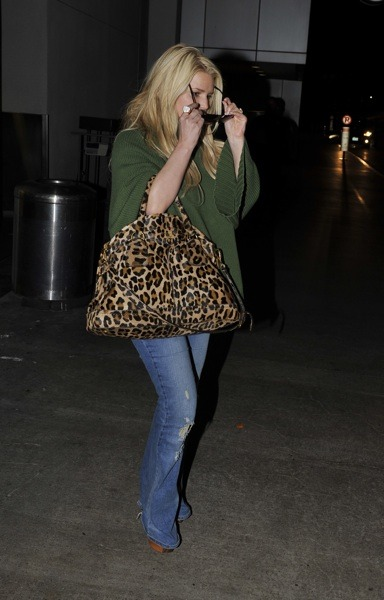 Jessica Simpson in army green sweater