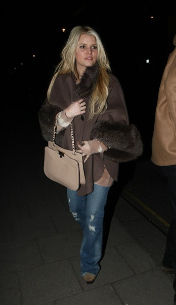 Jessica Simpson in brown cape with fur
