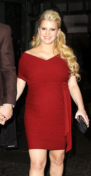 Jessica Simpson in belted red dress