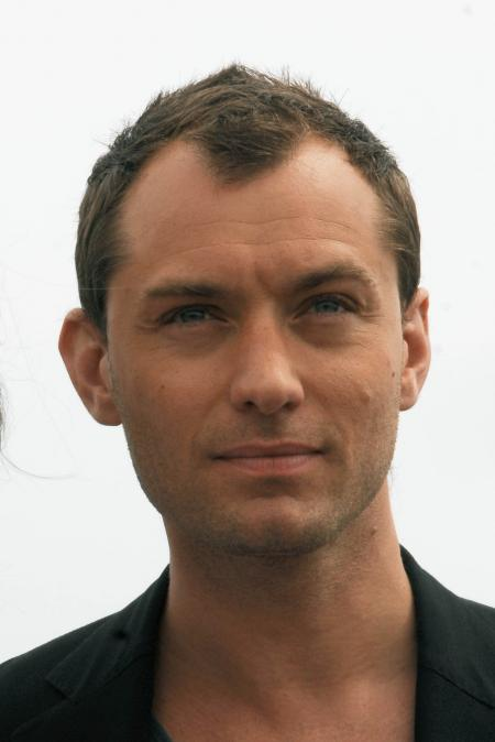 Jude Law is cleanly shaven with short hair