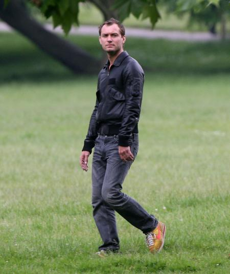 Jude Law walking in a park in London