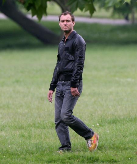 Jude Law walking in a park in London