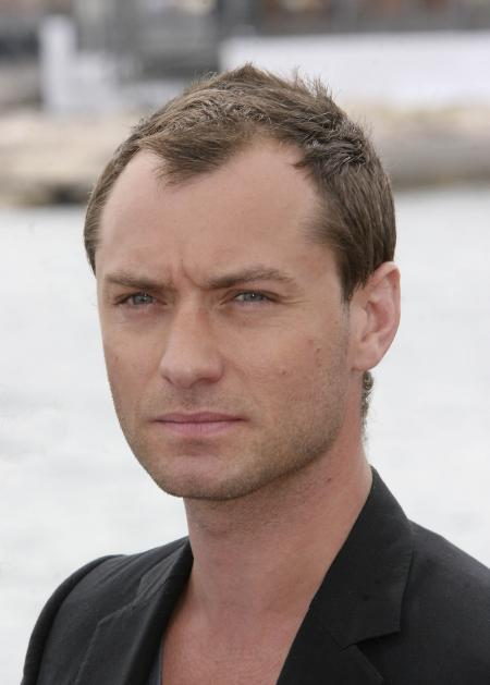 Jude Law gives the camera a sexy look