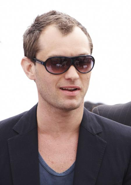Jude Law wears sunglasses and opens his mouth