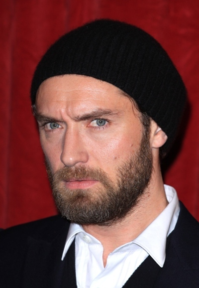 A scruffy Jude Law attends the premiere of  'Sherlock Holmes: A Game of Shadows'