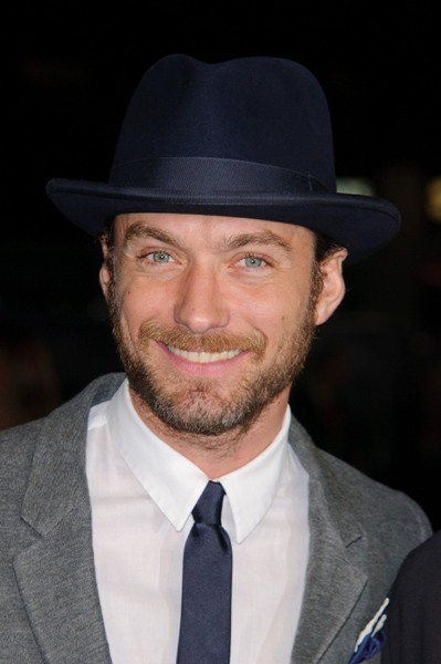 Jude Law wearing a black top hat at the London screening of 360