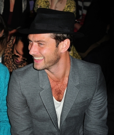 Jude Law shares a laugh with friends at London Fashion Week