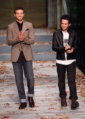 Justin Timberlake and Trace Ayala clap at a William Rast fashion event
