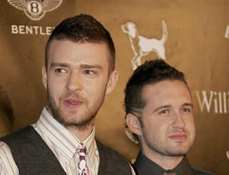 Justin Timberlake and Trace Ayala pose in front of a Bentley logo at Street Sexy