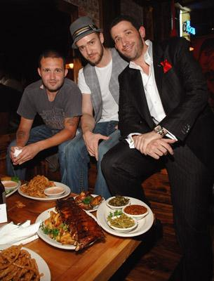 Justin Timberlake and Trace Ayala pose next to dinner