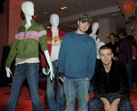 Justin Timberlake and Trace Ayala take a picture with mannequins at a mall