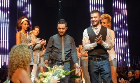 Trace Ayala and Justin Timberlake receive flowers at William Rast show