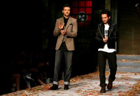 Justin Timberlake and Trace Ayala stand on the William Rast runway