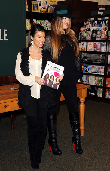 The two Kardashian sisters do a book signing in Calabasas