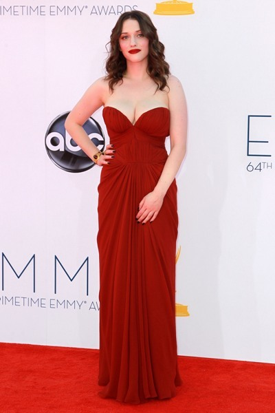 Kat Dennings poses for photographers at the Emmys.